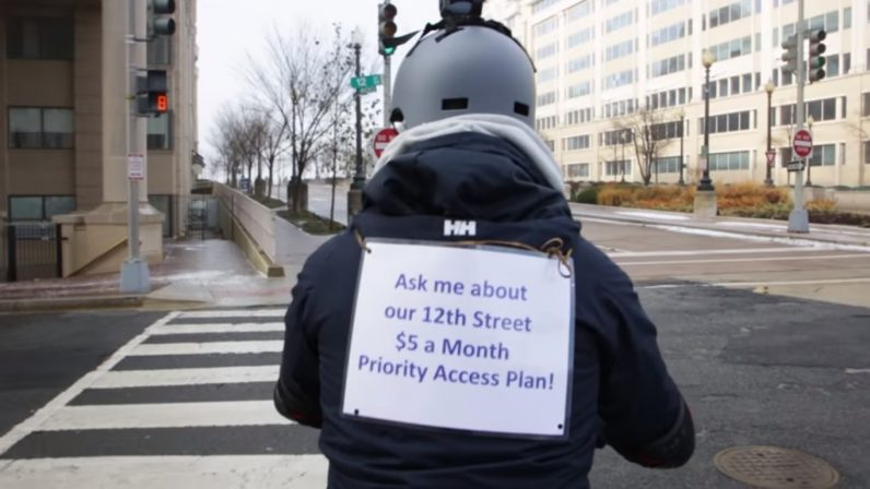 Net neutrality activist 'throttles' street traffic outside FCC building