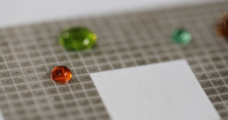 MIT researchers program water droplets to move and merge on command