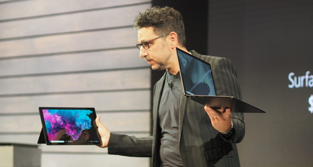 Panos Panay holding two Surface devices