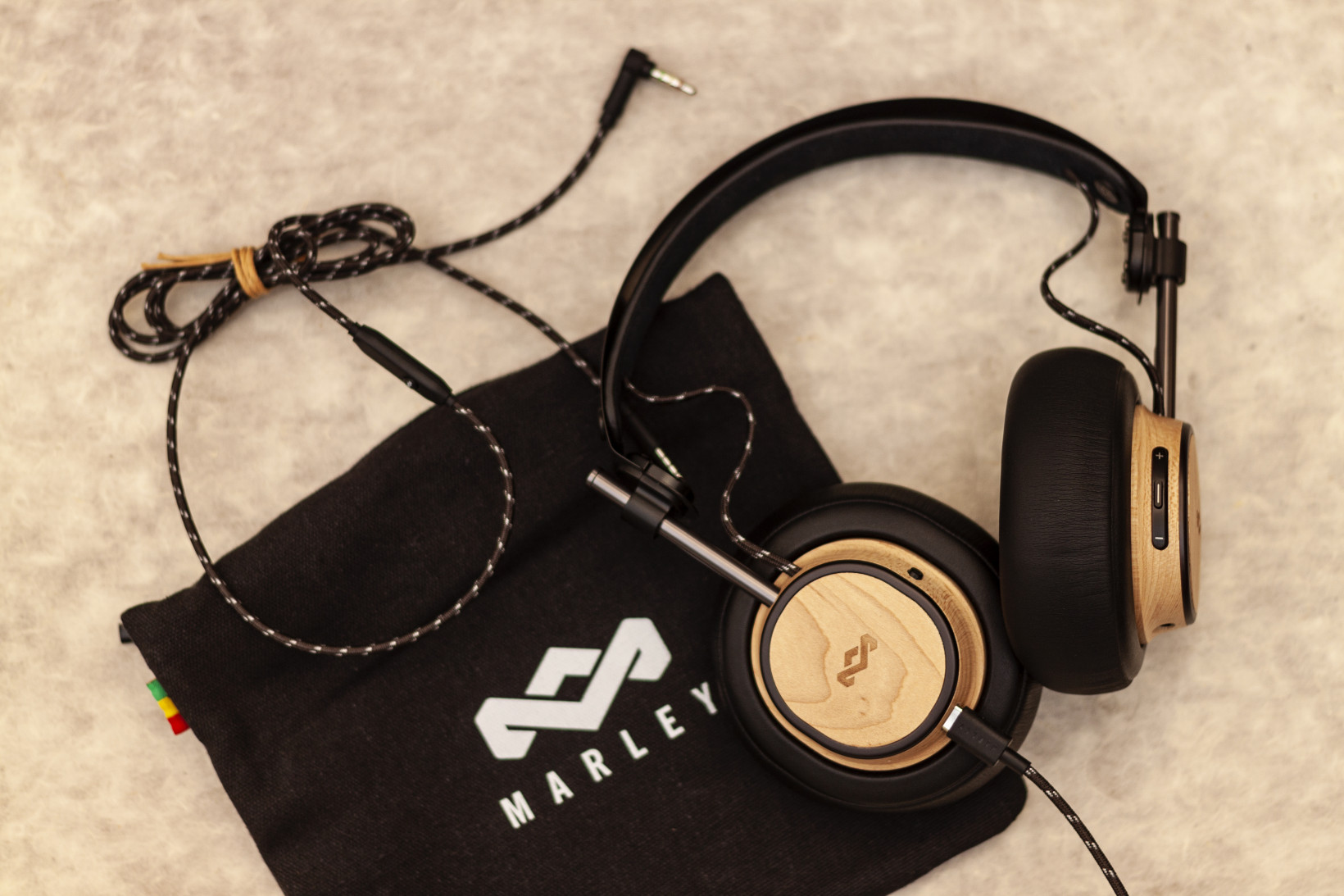 The Exodus headphones come with a 3.5mm cable, a USB-C charging cable, and a cloth carrying case
