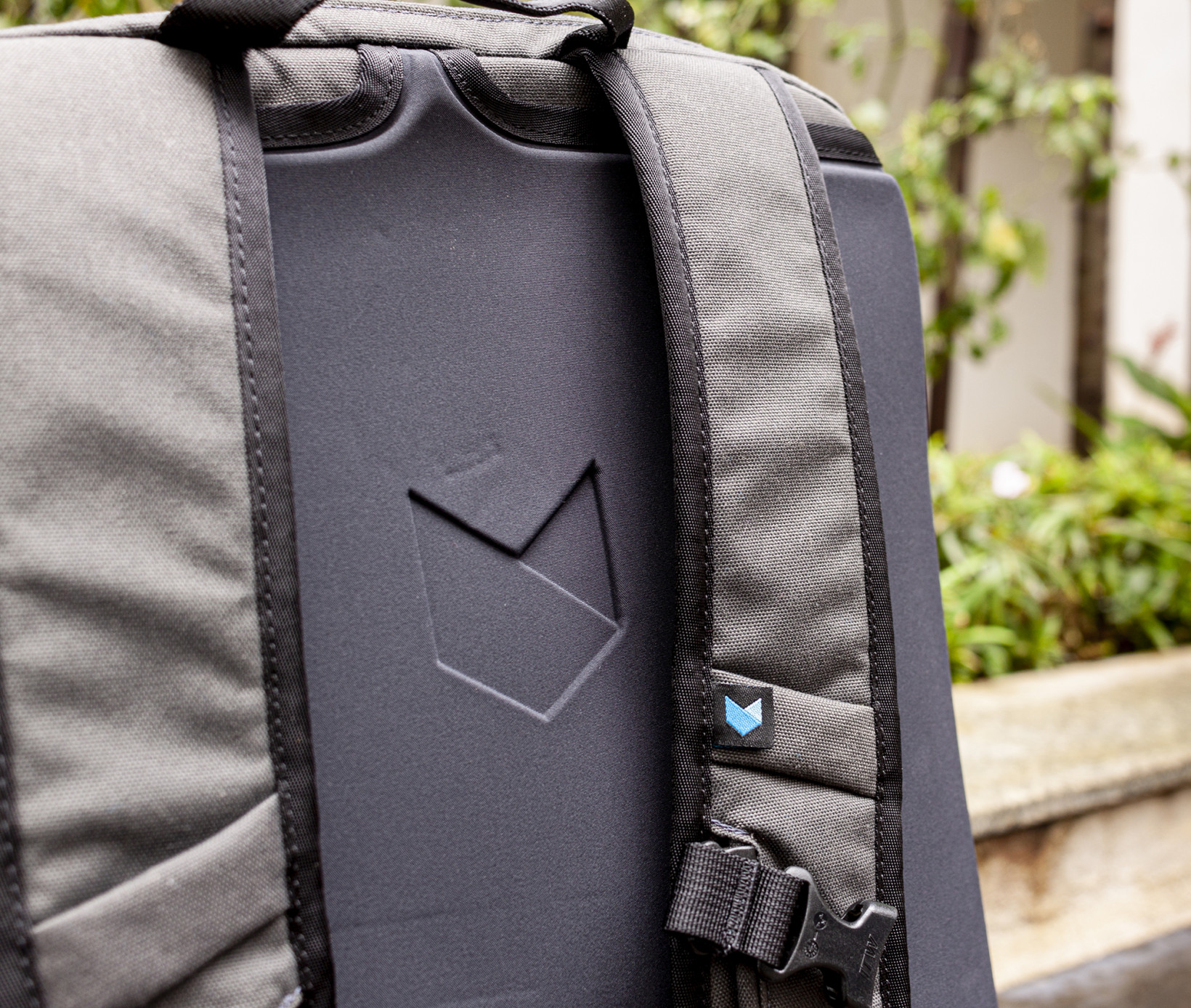 The Daily's rear panel has slots on top for stowing away the shoulder straps entirely; too bad it's not ventilated