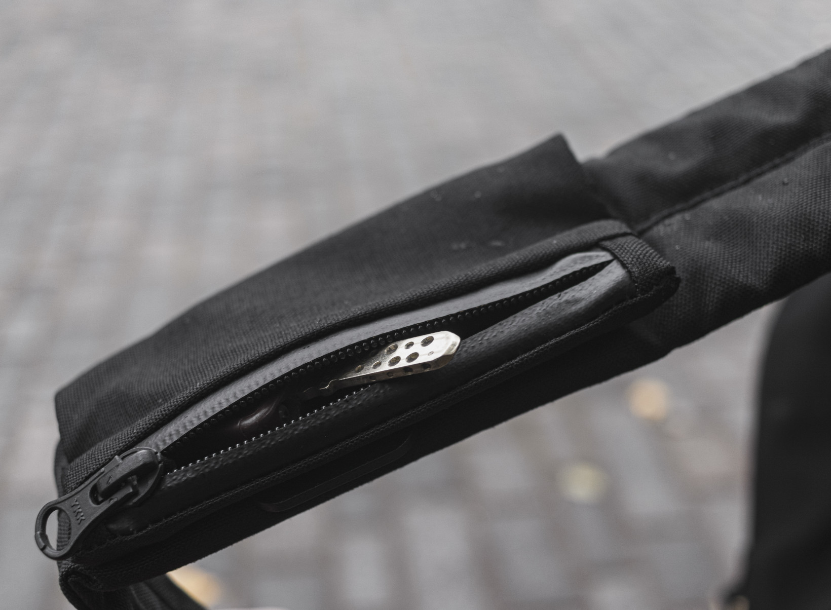 There are zippered pockets on the shoulder straps for small items like your keys