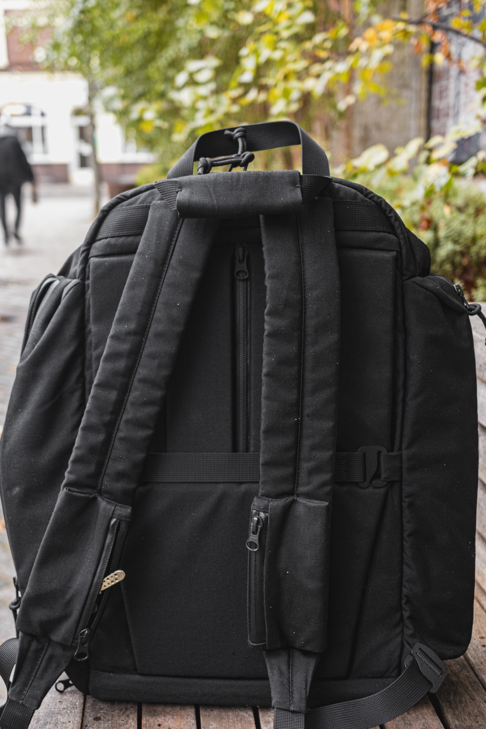 The A model backpack comes with secret pockets and a strap for carrying with rolling luggage