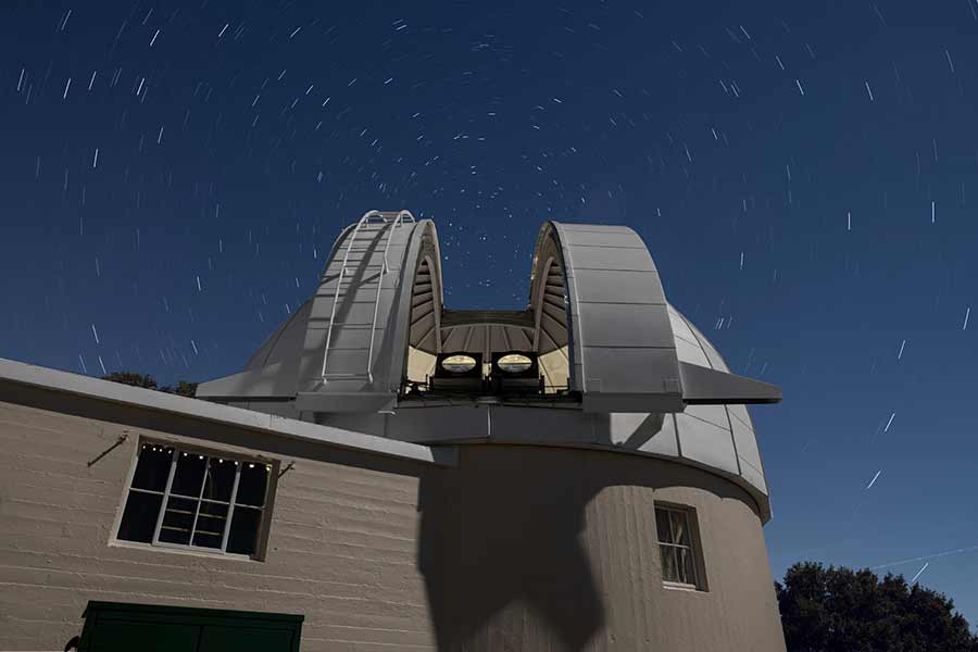 Two PANOSETI telescopes installed in the recently renovated Astrograph Dome at Lick Observatory. PANOSETI will utilize a configuration of many SETI telescopes to allow simultaneous monitoring of the entire observable sky.