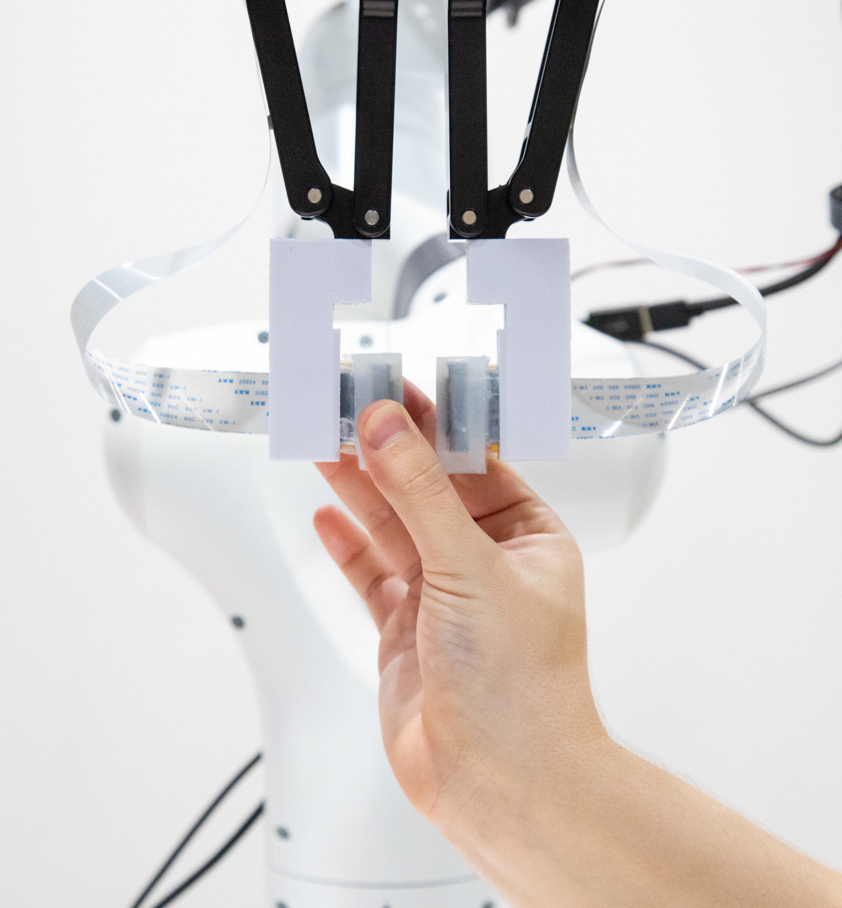 The system combines a neuromorphic brain with vision and touch data.