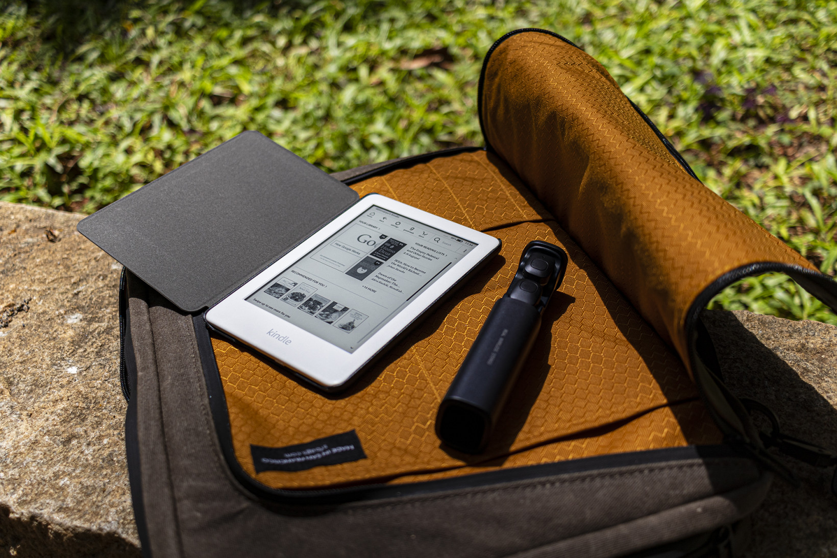The Tech Folio's front compartment can store small gadgets like earbuds and a Kindle, or even your laptop's charging brick