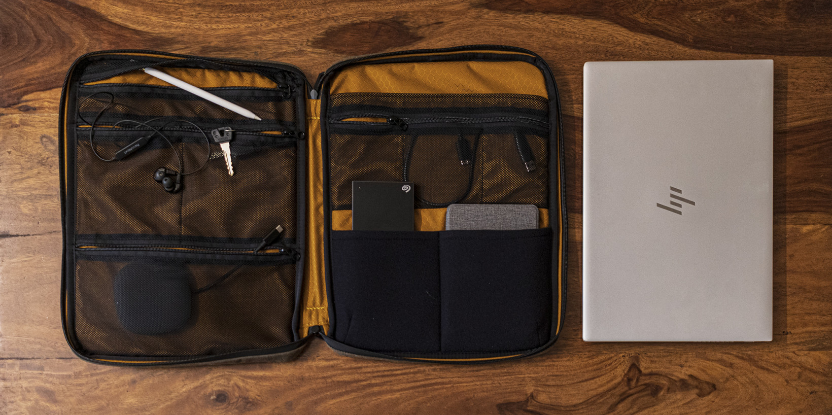 The Tech Folio's main compartment has mesh pockets so you can see where your smaller items are