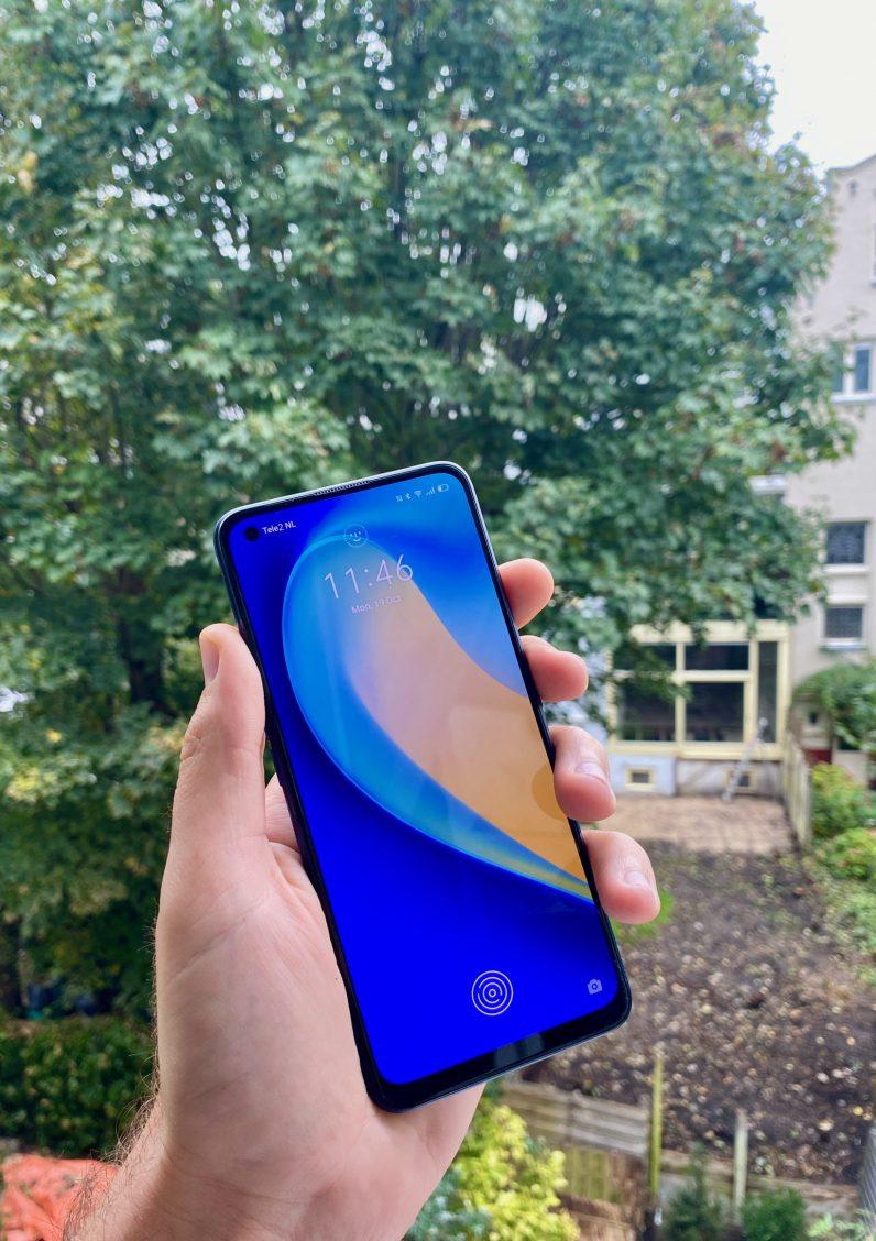 realme 7 pro holding phone