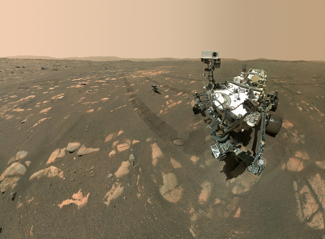 This image shows the Perseverance Mars rover with the Ingenuity helicopter about 4m behind it.