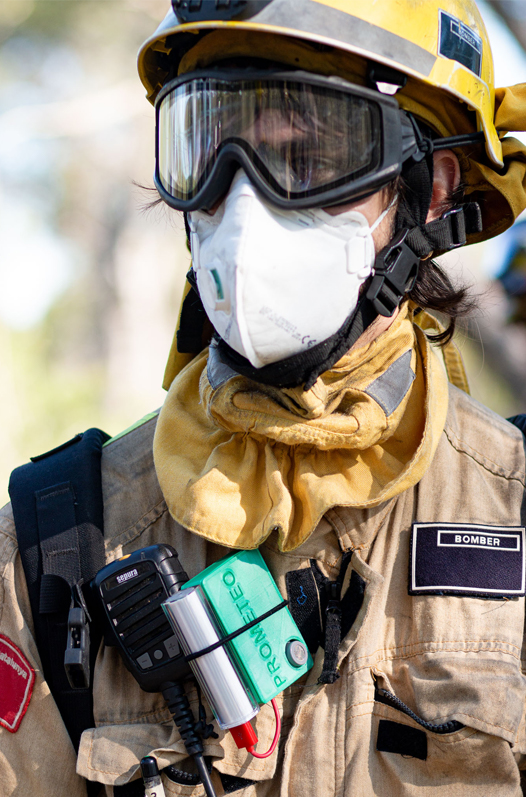 A firefighter wearing a Prometeo device
