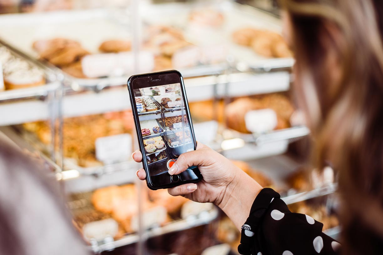 Smartphone being used to identify items at a grocery store