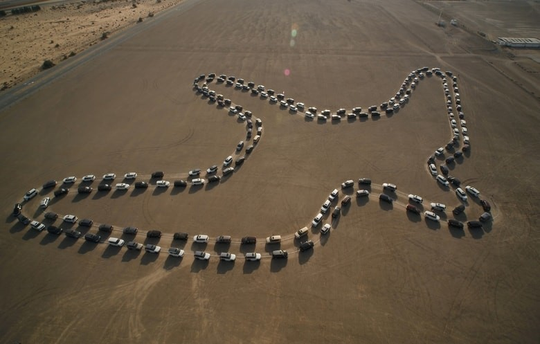 a formation of cars in the shape of a bird